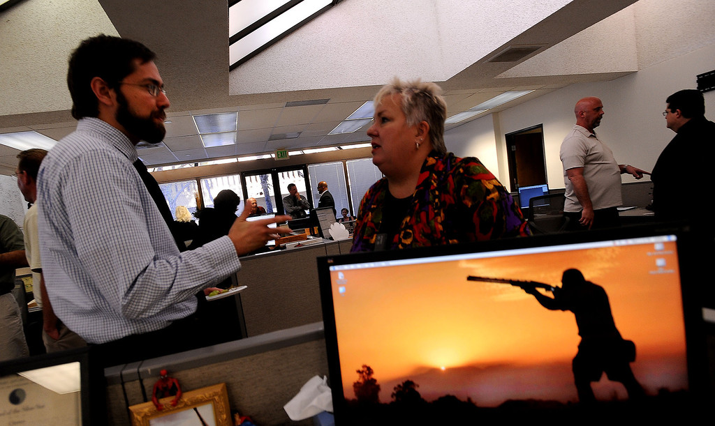 . Reporter Ryan Hagen, left, visits with  Laura Mancha, of Rolling Start, Inc. during The Sun\'s Open House in downtown San Bernardino March 13, 2013.  GABRIEL LUIS ACOSTA/STAFF PHOTOGRAPHER.