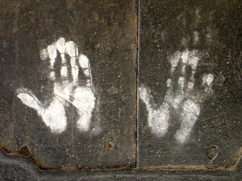 hand prints on monastery door