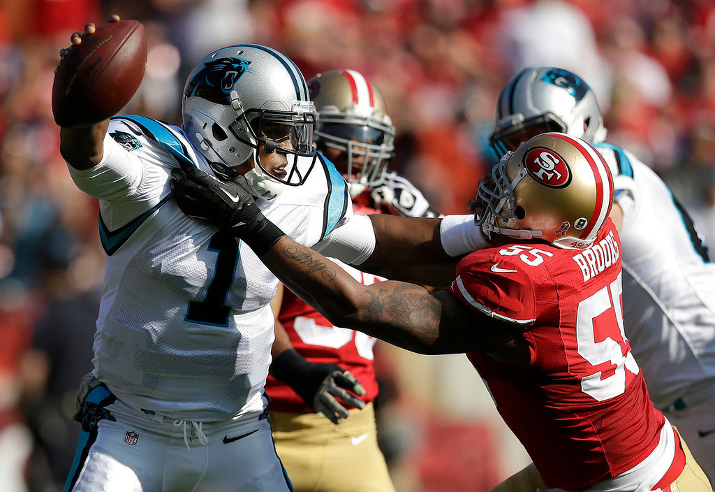 . Carolina Panthers quarterback Cam Newton (1) is sacked by San Francisco 49ers linebacker Ahmad Brooks (55) during the first quarter of an NFL football game in San Francisco, Sunday, Nov. 10, 2013. (AP Photo/Marcio Jose Sanchez)