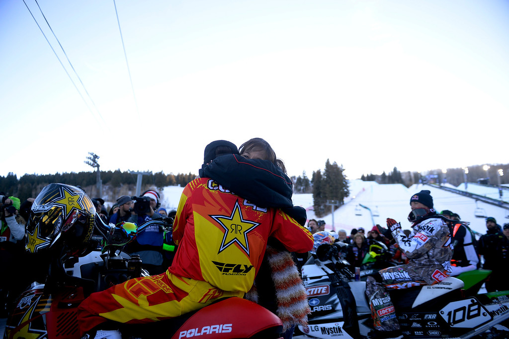 . ASPEN, CO - JANUARY 25: Colten Moore hugs his mother, Michelle, as they celebrate his late brother, Caleb, who was killed in the snowmobile freestyle event at the 2013 X Games Aspen. X Games Aspen at Buttermilk on Friday, January 25, 2014. (Photo by AAron Ontiveroz/The Denver Post)