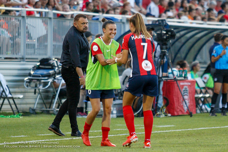 Washington Spirit midfielder Chloe Logarzo (6) and Washington Spirit midfielder/defender Amy Harrison (7) share a special handshake before the game at Maureen Hendricks Field in Boyds, MD, on July 20, 2019.