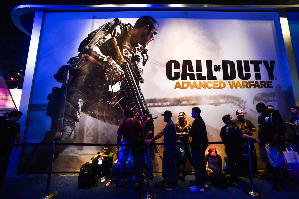 ". Attendees wait in line at the ""Call of Duty\"" game booth at Electronic Entertainment Expo in Los Angeles on Tuesday, June 10, 2014. (Photo by Watchara Phomicinda)"