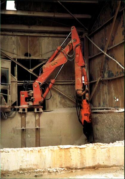 NPK B600 pedestal boom system with hydraulic hammer-rock breaking indoors.JPG