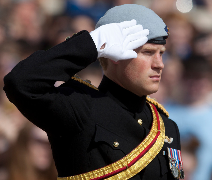 . Prince Harry salutes during a wreath laying ceremony at the Tomb of the Unknowns at Arlington National Cemetery in Arlington, Va Friday, May 10, 2013. (AP Photo/Carolyn Kaster)