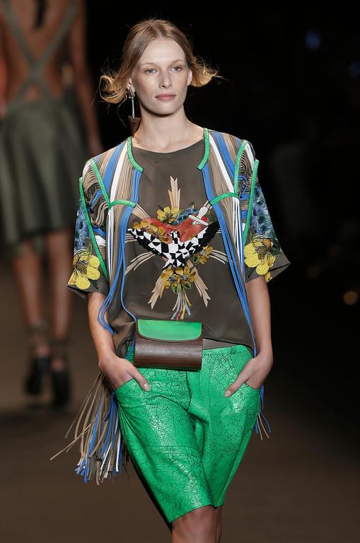 . A model wears a creation from the Espaco Fashion collection during Fashion Week in Rio de Janeiro, Brazil, Wednesday, April 9, 2014. (AP Photo/Silvia Izquierdo)