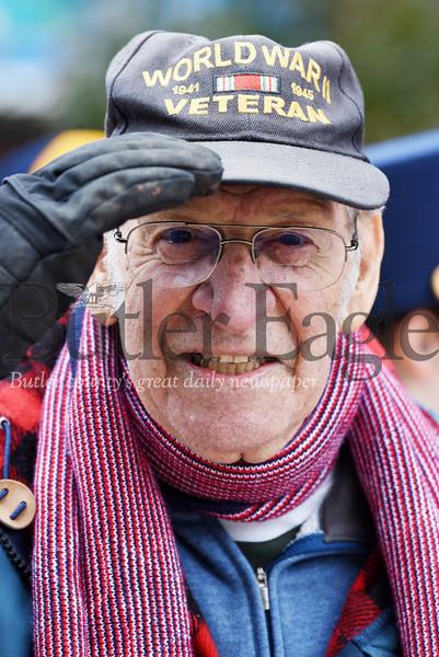 Harold Aughton/Butler Eagle: WW II Veteran, Tom Della Santa, 93, of Butler salutes the flag as the color guard passes during the Butler Veteran's Day Parade.