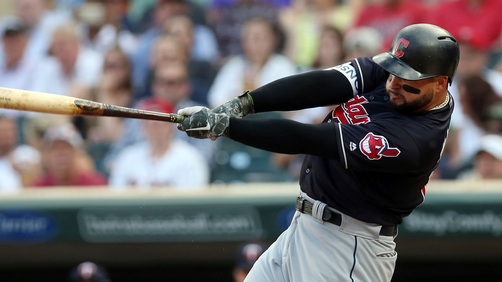 . Cleveland Indians\' Yonder Alonso bats against the Minnesota Twins in the first inning of a baseball game Thursday, May 31, 2018, in Minneapolis. (AP Photo/Jim Mone)