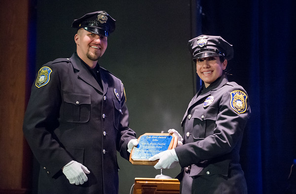 04/12/19 Wesley Bunnell | Staff The Regional Satellite Basic Recruit Academy graduated thirteen recruits covering five towns with seven recruits going to the New Britain Police Department. New Britain Ofc. Joseph Blansfield , Range Master NB Police Department, presents an award to Ofc. Megan Fazekas.