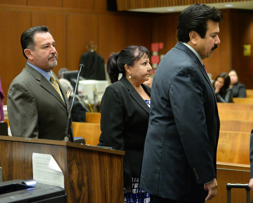 . Irwindale City Councilmen Mark Breceda, left, Manuel Garcia, right, and former City Councilwoman Rosemary Ramirez, who have been charged with embezzlement, misappropriation of public funds and conflict of interest, appear in court to postpone their arraignment at the Clara Shortridge Foltz Criminal Justice Center in Los Angeles on Wednesday January 29, 2014. They will next appear on February 27th. (Staff Photo by Keith Durflinger/San Gabriel Valley Tribune)