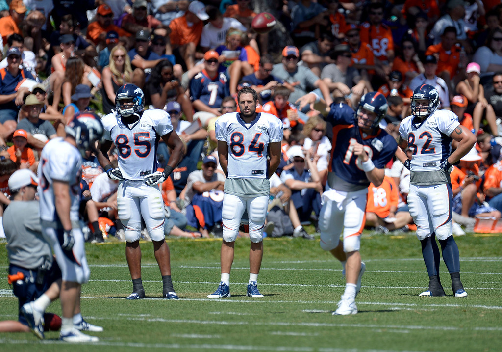 . Denver Broncos TE Virgil Green (85) Jacob Tamme (84) Jake O\'Connell (82) watch QB Peyton Manning (18) run the offense during training camp August 5, 2013 at Dove Valley. (Photo By John Leyba/The Denver Post)