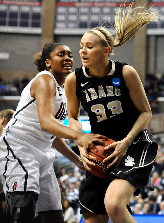 . Idaho\'s Alyssa Charlston, right, hangs onto a rebound against Connecticut\'s Morgan Tuck in the first half of a first-round game in the women\'s NCAA college basketball tournament in Storrs, Conn., Saturday, March 23, 2013. (AP Photo/Jessica Hill)