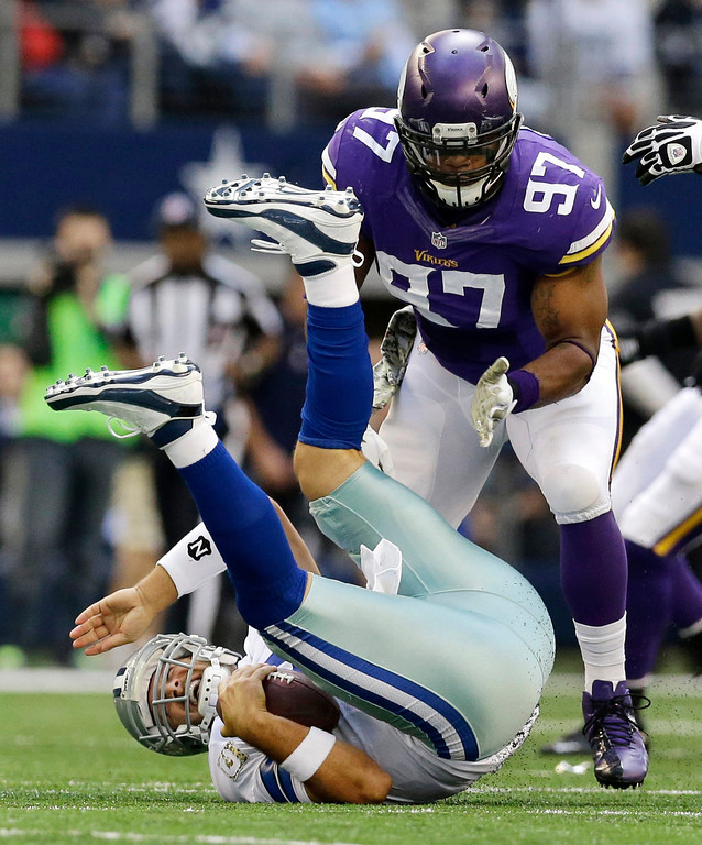 . Dallas Cowboys quarterback Tony Romo (9) is sacked by Minnesota Vikings\' Everson Griffen (97) in the first half of an NFL football game, Sunday, Nov. 3, 2013, in Arlington, Texas. (AP Photo/Nam Y. Huh)