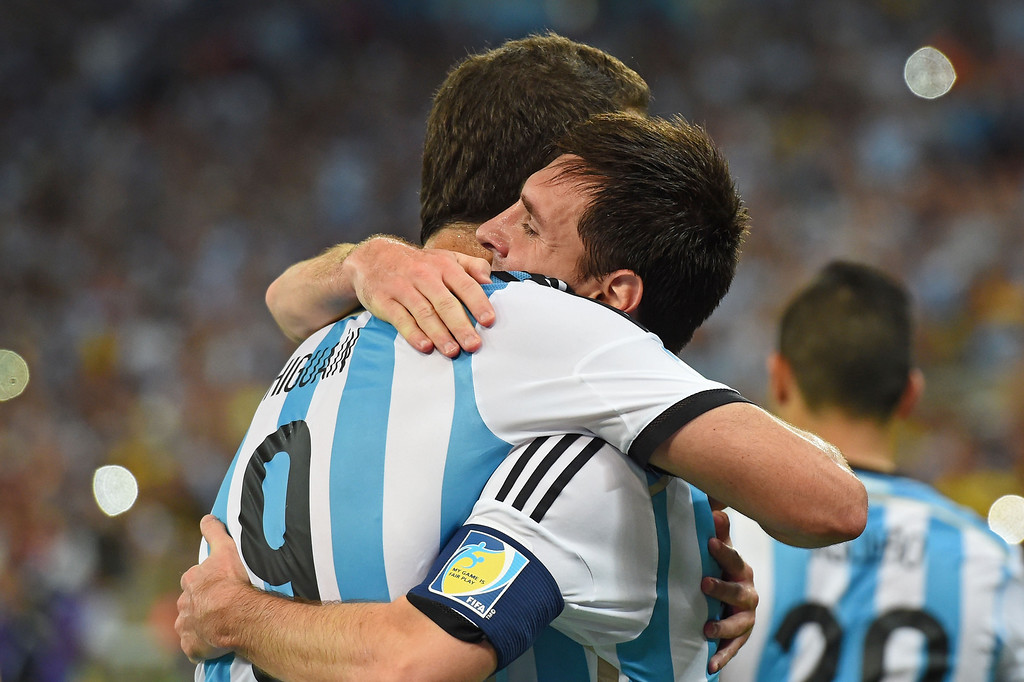 . Gonzalo Higuain of Argentina and Lionel Messi celebrate defeating Bosnia Herzegovina 2-1 in the 2014 FIFA World Cup Brazil Group F match between Argentina and Bosnia-Herzegovina at Maracana on June 15, 2014 in Rio de Janeiro, Brazil.  (Photo by Matthias Hangst/Getty Images)