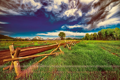 After a storm swept through; buckrail fence in a meadow, Grand Teton National Park