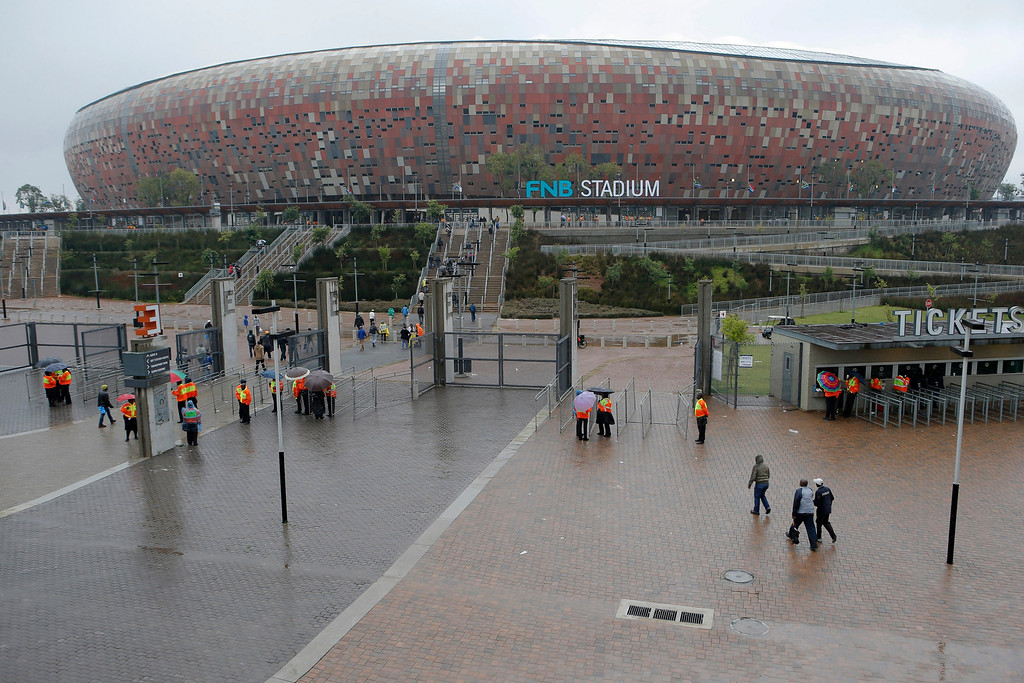 . A trickle of people arrive for the memorial service for former South African president Nelson Mandela at the FNB Stadium in Soweto, near Johannesburg, South Africa, Tuesday Dec. 10, 2013. (AP Photo/Tsvangirayi Mukwazhi)