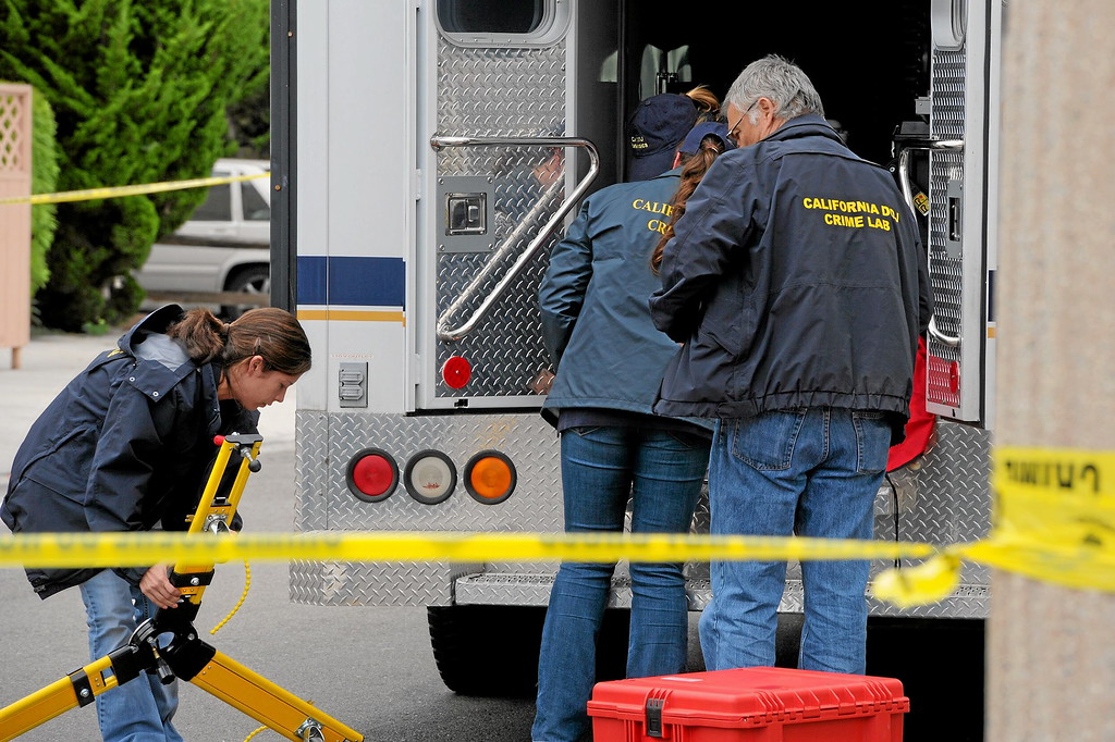 . California Department of Jusctice investigators load equipment on Sabado Tarde Road at the scene of Friday night\'s shooting in Isla Vista, Saturday, May 24, 2014. (Photo by Michael Owen Baker/Los Angeles Daily News)