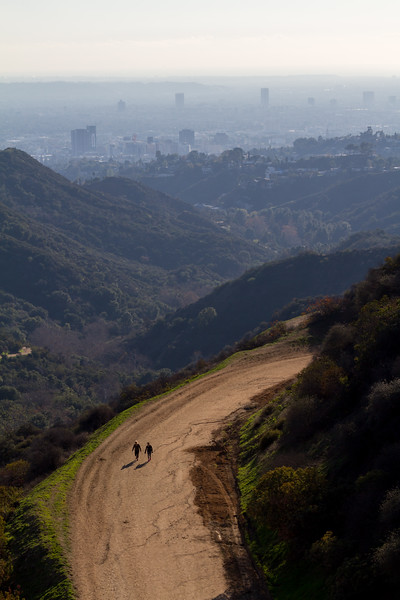 People hiking up to Hllywood Sign with Santa Monica and Pacific Ocean in background - USA - California - Los Angeles