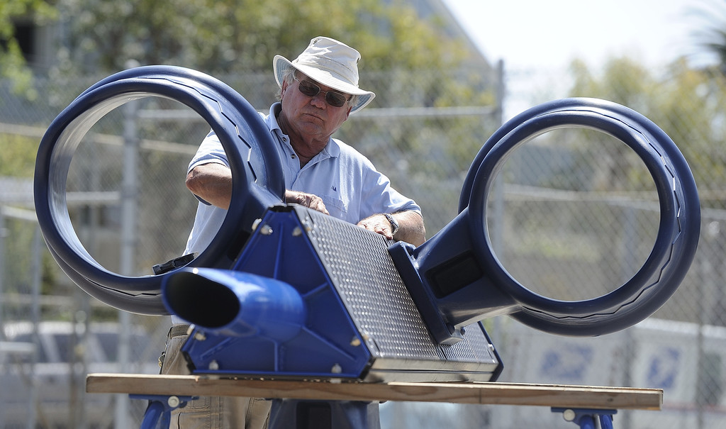 . LONG BEACH, CALIF. USA -- Jim Howe assembles a three-sided basketball hoop during a one-day playground build at Edison Elementary School in Long Beach, Calif., on April 6, 2013.  More than 200 volunteers from the Long Beach Unified School District, Green Long Beach! and Zynga, joined organizers from KaBOOM! and residents to build a new playground at the Edison Child Development Center.  The playground is the fourth built by KaBOOM! and Zynga.org and is one of more than 150 playground builds KaBOOM! will lead across the country in 2013 in an effort to fulfill its vision of a great place to play within walking distance of every child in America. Photo by Jeff Gritchen / Los Angeles Newspaper Group