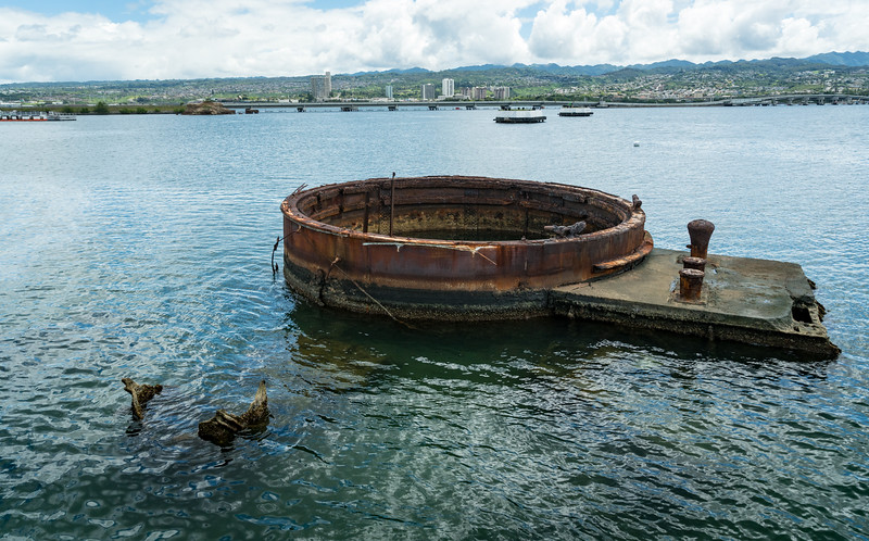 Base of Gun Turret 3.  Arizona's stern is marked by a white buoy about 2:00 from the turret.