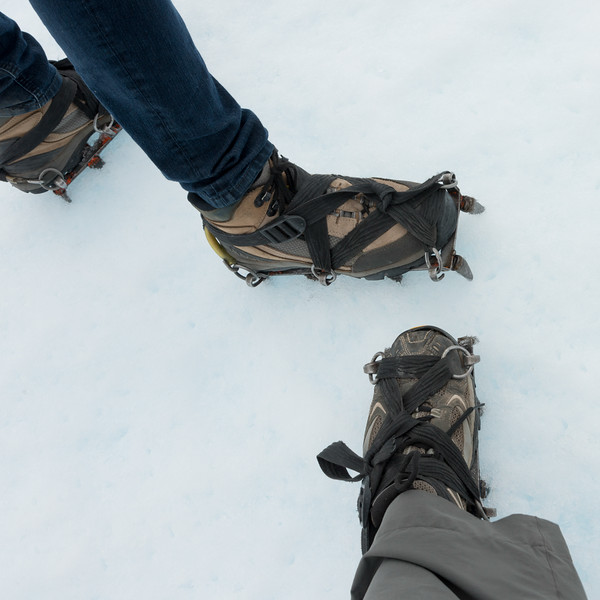 Low section view of hikers with shoe and crampon in snow, Perito Moreno Glacier, Los Glaciares National Park, Santa Cruz Province, Patagonia, Argentina