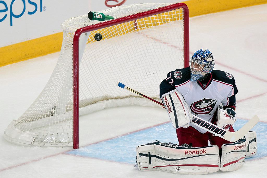 . Columbus Blue Jackets goalie Sergei Bobrovsky (72), of Russia, blocks a shot against the Colorado Avalanche during the first period of an NHL hockey game on Monday, April 15, 2013 in Denver. (AP Photo/Barry Gutierrez)