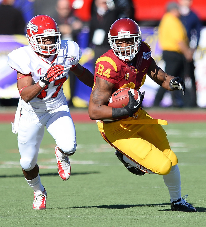 . LAS VEGAS, NV - DECEMBER 21:  Darreus Rogers #84 of the USC Trojans runs for yardage ahead of Jonathan Norton #37 of the Fresno State Bulldogs during the Royal Purple Las Vegas Bowl at Sam Boyd Stadium on December 21, 2013 in Las Vegas, Nevada. USC won 45-20.  (Photo by Ethan Miller/Getty Images)