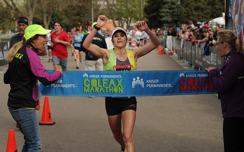 . Nicole Chyr is the first female runner to cross the finish line of the Colfax Marathon in City Park on May 19, 2013. She won the race with the record time of 2:57:18. The Colfax Marathon, the Half Marathon and the Urban Ten-Miler were held in City Park in Denver, CO on May 19th, 2013. The popular running events, sponsored by Kaiser Permanente, were sold out and thousands of runners took part in all three races.  Temperatures were cool with cloudy skies making for record setting times on both the marathon and the half marathon by the winners.  (Photo by Helen H. Richardson/The Denver Post)