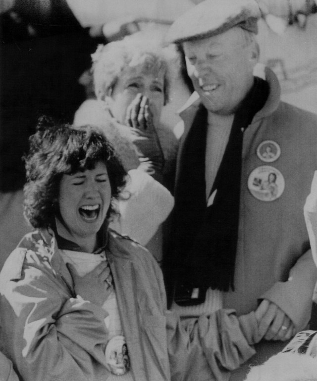 . Betsy Corrigan, sister of Christa McAuliffe, reacts as she watches the Space Shuttle Challenger explode at the Kennedy Space Center in Florida, Tuesday, Jan. 28th, 1986. Behind Corrigan are Christa\'s parents Grace Corrigan (right) and father Ed. Denver Post Library Archive