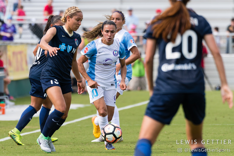 Marta (10) and Jaelene Hinkle (15) during a match between the NC Courage and the Orlando Pride in Cary, NC in Week 3 of the 2017 NWSL season. Photo by Lewis Gettier.