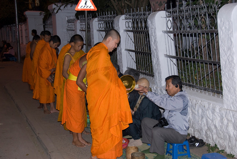 More scenes during alms giving ceremony in Luang Prabang, Laos
