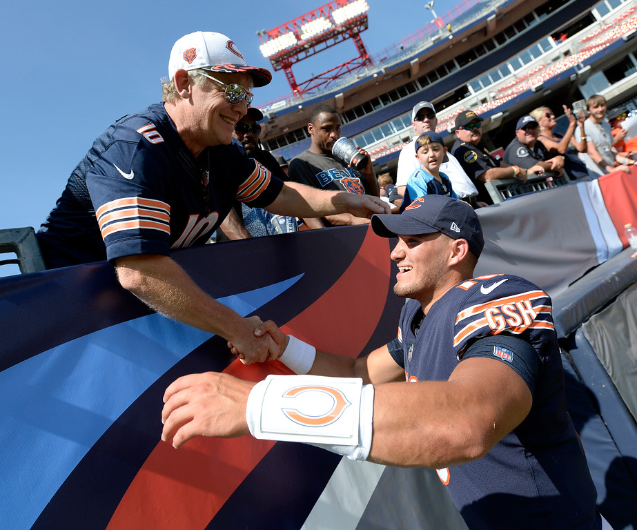 . Chicago Bears quarterback Mitchell Trubisky, right, greets a fan after an NFL football preseason game against the Tennessee Titans Sunday, Aug. 27, 2017, in Nashville, Tenn. The Bears won 19-7. (AP Photo/Mark Zaleski)