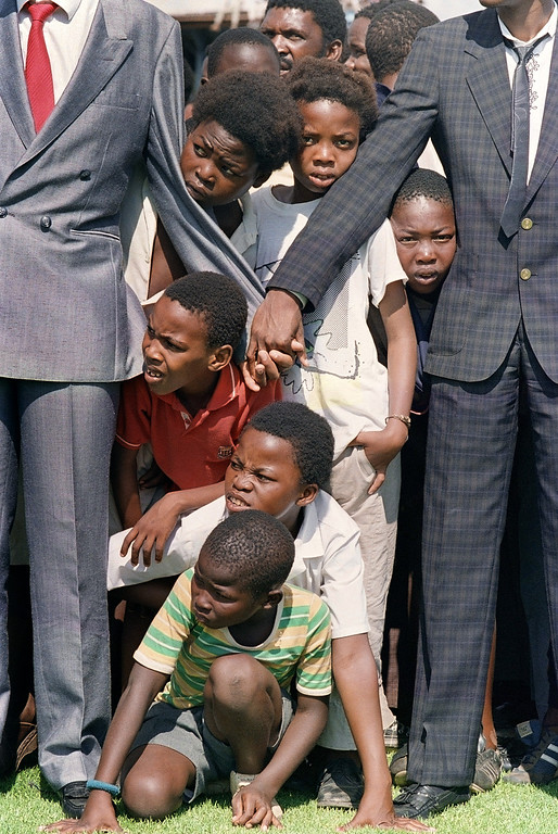 . Young boys try to see anti-apartheid leader and African National Congress (ANC) member Nelson Mandela at Orlando soccer stadium 12 February 1990 whilst thousands of Sowetans wait for him. Mandela arrived in Johannesburg this evening but has not been to Soweto yet.        ( ALEXANDER JOE/AFP/GettyImages)
