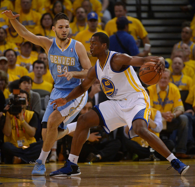 . OAKLAND, CA - APRIL 28:Evan Fournier (94) of the Denver Nuggets guards Harrison Barnes (40) of the Golden State Warriors during the first quarter in Game 3 of the first round NBA Playoffs April 28, 2013 at Oracle Arena. (Photo By John Leyba/The Denver Post)