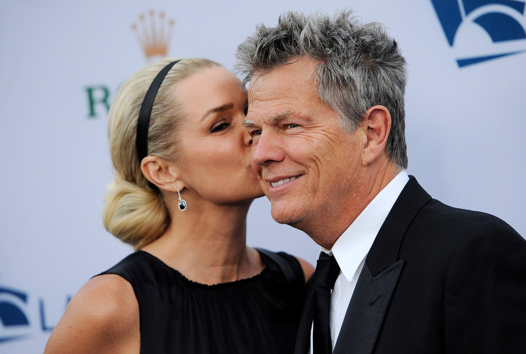 . Music producer David Foster gets a kiss from girlfriend Yolanda Hadid at the Los Angeles Philharmonic Opening Night Gala, Tuesday, Sept. 27, 2011, in Los Angeles. (AP Photo/Chris Pizzello)