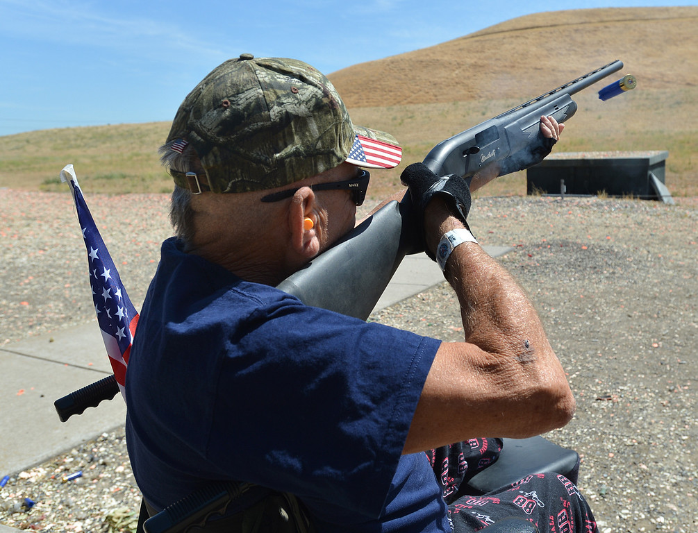 . Earl Batterton, of San Jose, a U.S. Army Vietnam veteran, takes his first try at trap shooting during the George Findly Memorial Disabled Veteran Trap Shoot at the Bay Point Rod and Gun Club in Concord, Calif., on Saturday, June 15, 2013. Each vet was assigned a mentor/coach from the club and each got to shoot two sets of flying clay targets. (Dan Rosenstrauch/Bay Area News Group)