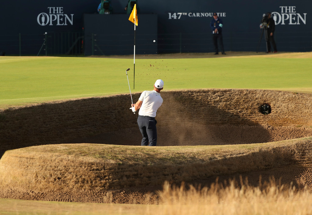 . Paul Casey of England plays out of a bunker on the 18th hole during the second round of the British Open Golf Championship in Carnoustie, Scotland, Friday July 20, 2018. (AP Photo/Peter Morrison)