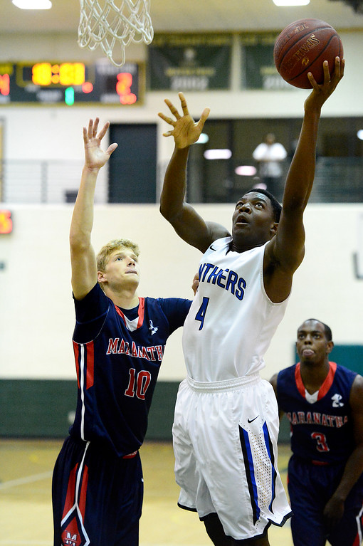 . Diamond Ranch\'s Nnadi Udengwu goes for a shot as Maranatha\'s Michael DeMeester and Jeremy Major approach during the 10th annual Tribune/Star-News boys/girls basketball all-star classic Friday night, April 26, 2013 at Damien High School in La Verne. (SGVN/Staff Photo by Sarah Reingewirtz)