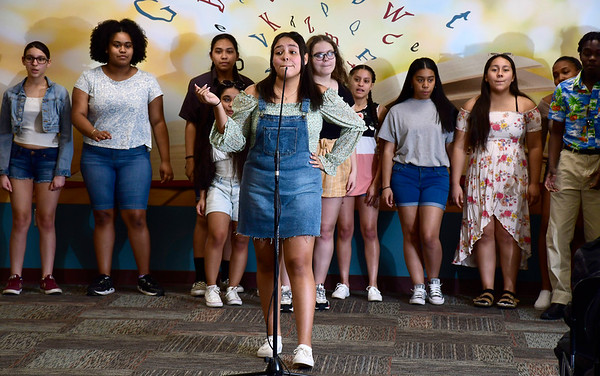 3/4/2020 Mike Orazzi | Staff New Britain High School Student Naylea Blanco (front) during a performance of Mamma Mia! at the New Britain Public Library on Wednesday night. The full show will be performed at New Britain High School on March 20 & 21st.