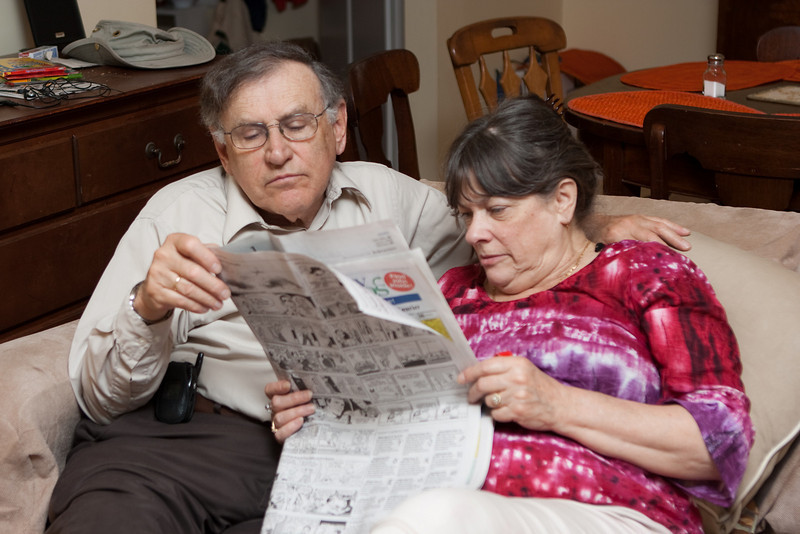 Mom and Richard work on the crossword puzzle.