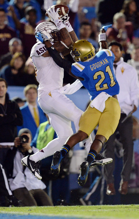 . Arizona State�s Jaelen Strong #21 hauls in a touchdown pass as UCLA�s Tahaan Goodman #21 defends in the first half during their game at the Rose Bowl Saturday November 23, 2013. (Photos by Hans Gutknecht/Los Angeles Daily News)