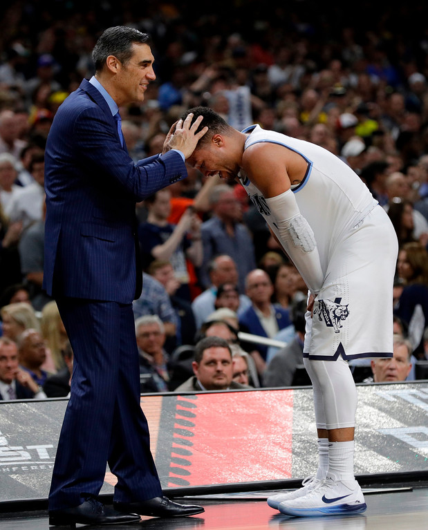 . Villanova head coach Jay Wright hugs Jalen Brunson as they celebrate after the championship game of the Final Four NCAA college basketball tournament against Michigan, Monday, April 2, 2018, in San Antonio. Villanova won 79-62. (AP Photo/David J. Phillip)