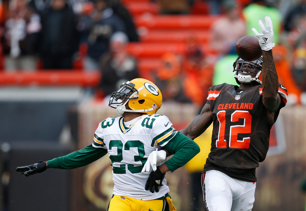 . Cleveland Browns wide receiver Josh Gordon (12) reaches but can\'t hold onto the ball against Green Bay Packers cornerback Damarious Randall (23) in the second half of an NFL football game, Sunday, Dec. 10, 2017, in Cleveland. (AP Photo/Ron Schwane)