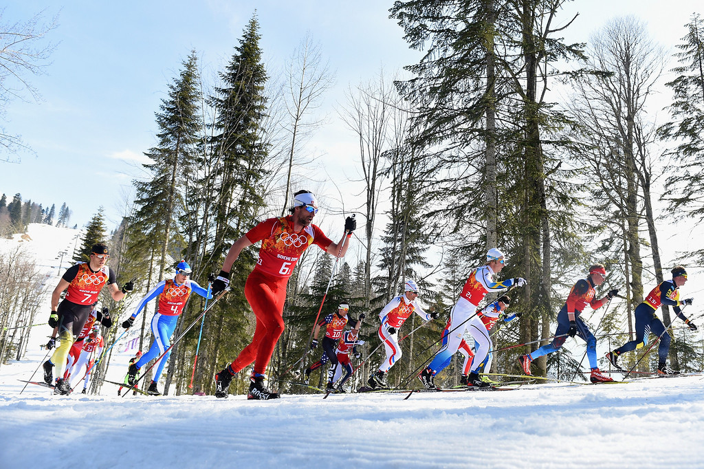 . Cross country skiers compete on the first leg of the Cross Country Men\'s 4 x 10 km Relay during day nine of the Sochi 2014 Winter Olympics at Laura Cross-country Ski & Biathlon Center on February 16, 2014 in Sochi, Russia.  (Photo by Harry How/Getty Images)