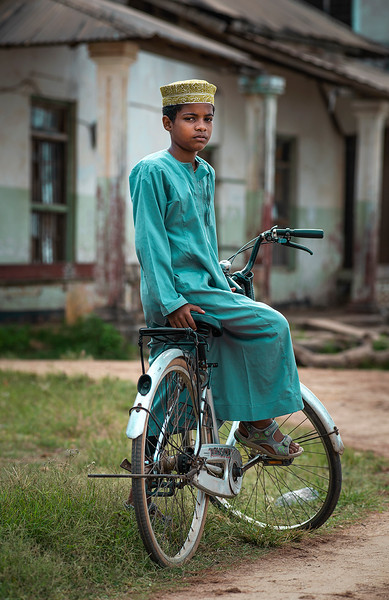 A young Muslim man on his bicycle.  Pangani, Tanzania, 2019.