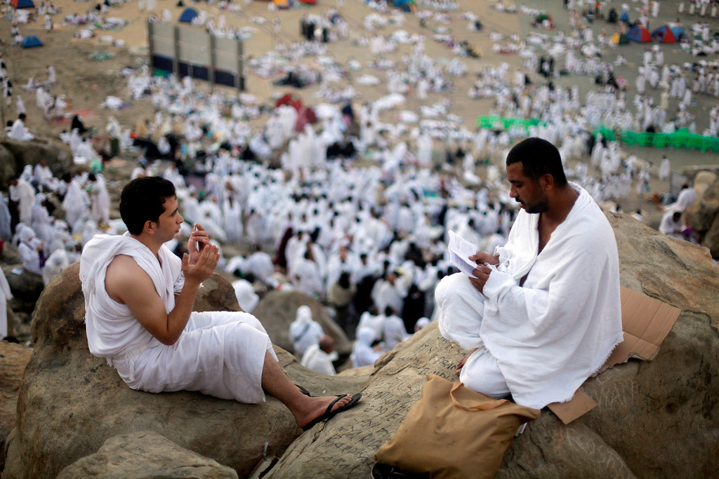 . Muslim pilgrims pray on a rocky hill called the Mountain of Mercy, near the holy city of Mecca, Saudi Arabia, Monday, Oct. 14, 2013. The hajj, a central pillar of Islam and one that able-bodied Muslims must make once in their lives, is a four-day spiritual cleansing based on centuries of interpretation of the traditions of Prophet Muhammad. (AP Photo/Amr Nabil)