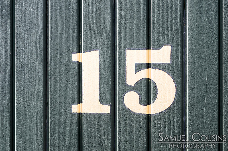 Number 15 on the side of a train car at the Narrow Gauge Railway