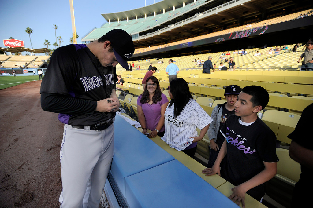 . Nolan James Arenado plays 3rd base for the Colorado Rockies. Here he signs autographs before a game with the Los Angeles Dodgers. Los Angeles, CA 5/1/2013(John McCoy/Staff Photographer)