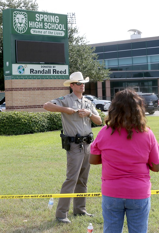 . Katherine Womack who has two grandchildren attending Spring High School, tries to talk to an officer after a stabbing at Spring High School September 4, 2013 in Spring, Texas.  (Photo by Thomas B. Shea/Getty Images)