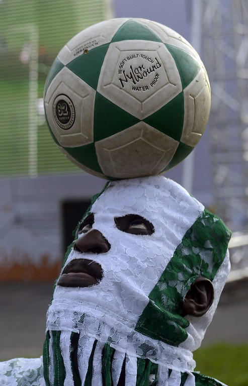 . A man heads the ball to entertain fans of Nigeria national soccer team at a viewing centre in Lagos on June 25, 2014 during the 2014 FIFA World Cup Brazil Group F match between Nigeria and Argentina at Estadio Beira-Rio in Porto Alegre, Brazil. AFP PHOTO/PIUS UTOMI EKPEI/AFP/Getty Images