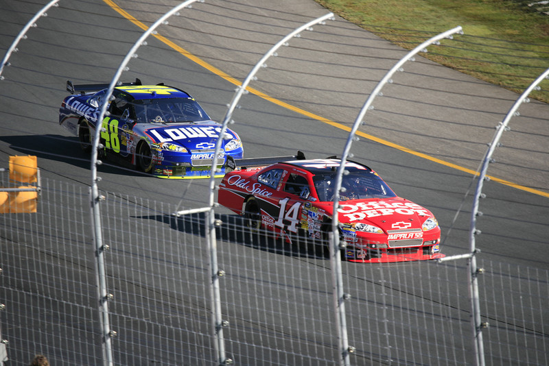 Tony Stewart and Jimmy Johnson fighting for the lead